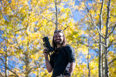Photographer in aspen grove