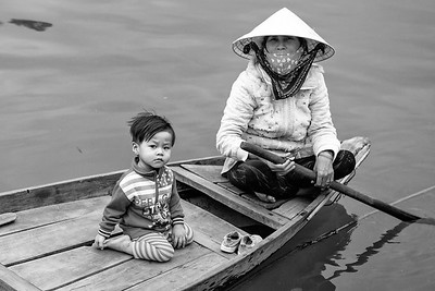 Boat Woman and child Hoi An Vietnam