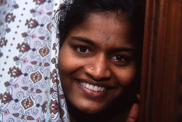 "Selverani worked as a ""servant"" in the house where the NGIO, R.I.D. E. is located.  She is a ""Dalit"" (untouchable), and has been taken in by the family that manages R.I.D.E., and basicallyt became a family member.  When this photo was taken she was about 22, and shortly therreafter, her 45 year old uncle with two children, whose wife recently died, declared that she would have to become his wife.  Selverani had no choice but to accept.  R.I.D.E.'s mission is to help end child labor in the silk sari weaving industry of Kanchipurim."