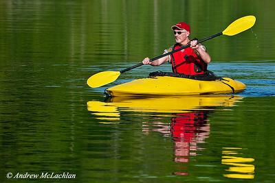 Adult Male Kayaking in Muskoka, Ontario, Canada