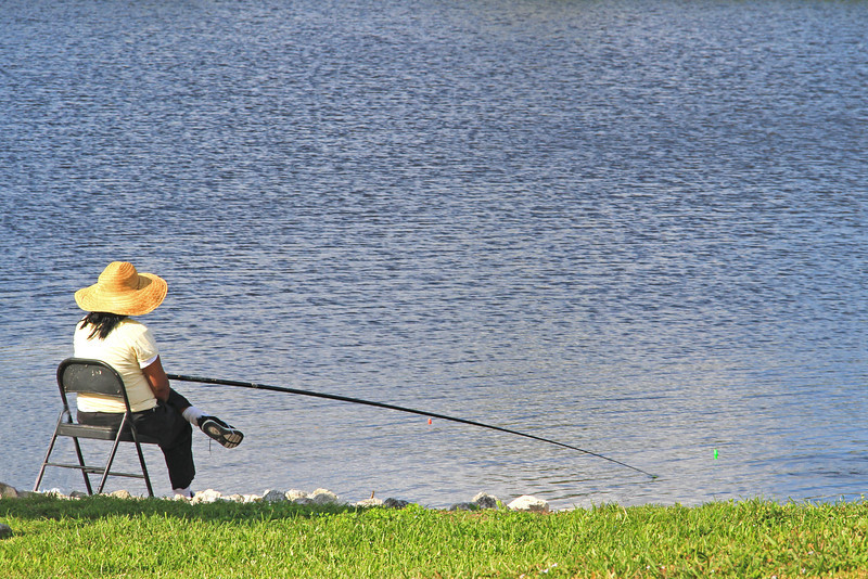 Woman Fishing. Near Lake Okeechobee, FL.