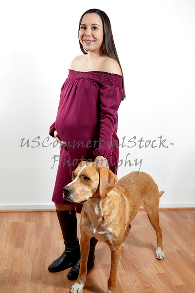 Pregnant Young Woman with her Dog
