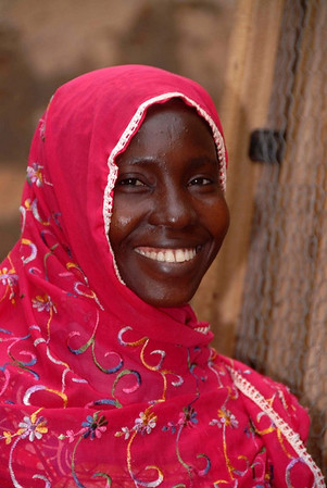 This Muslim woman is a recipient of sheep from Heifer International through Pro-Link, and NGO in Ghana.  This photo was taken as a part of volunteer work by Peter Schnurman, the photographer, and his wife Hinda who were both volunteering for Pro-Link from May - Septenmber 2006.  This woman lived in a Muslim village near Hohoe.  In addition to ProLink's project with Heifer International, the women and the men in this villlag also participated in a program run by ProLink to learn about HIV/AIDS and reproductive health.
