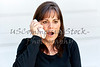 Middle Aged Woman with a Surprised Expression while on the Phone