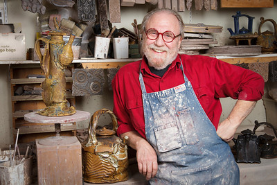 Business portrait of a potter in his ceramics studio.