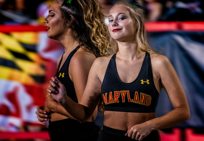 Cheerleader gets ready to perform before a football game