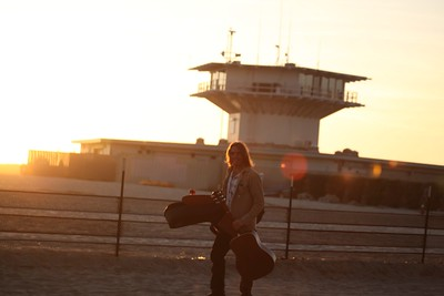 Peter Goetz plays to a setting sun.