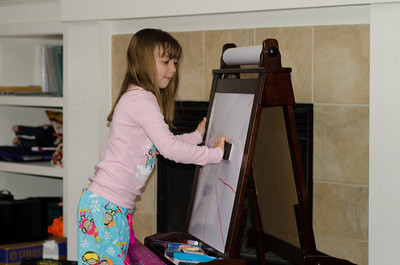Lilly enjoying her new easel.