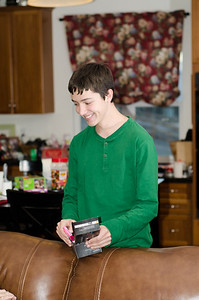 Boston opening his new cell phone (a plastic pink baby toy).