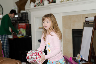 Lilly amazed at the shape of this gift.