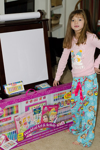 Lilly is just amazed with her new easel and art supplies.