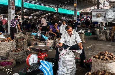 Vendor With Newspaper. Silvia Market, Colombia