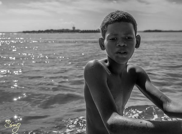 Boy Relaxing In the Water. Playa Blanca, Colombia