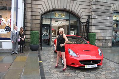 The Ferrari man looks on