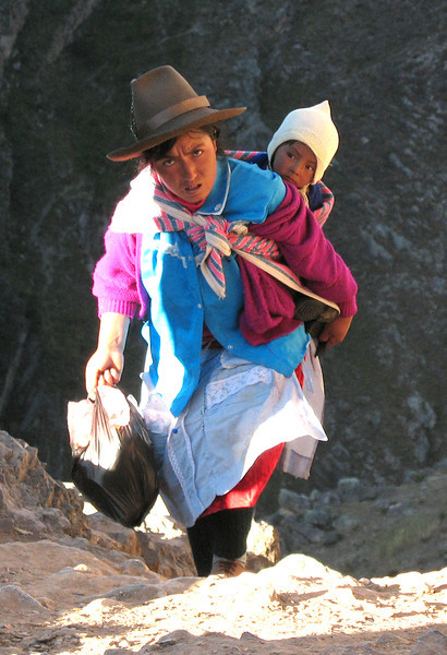Woman with baby on the strenuous trail ascending from Chavin de Huantar towards Shongopampa