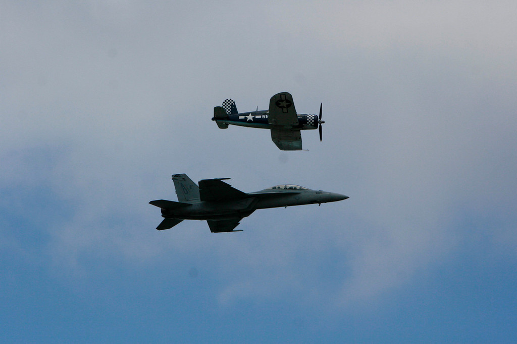 F-4 Corsair (WWII carrier-launched fighter) and the present day carrier-launched F/A-18 fighter.)