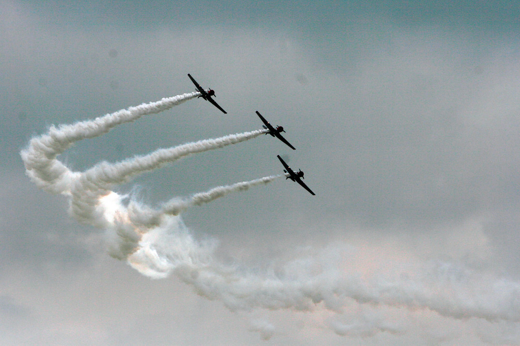 """WWII SNJ-2 aircraft, now comandeered by GEICO as """"Skytypers."""""""