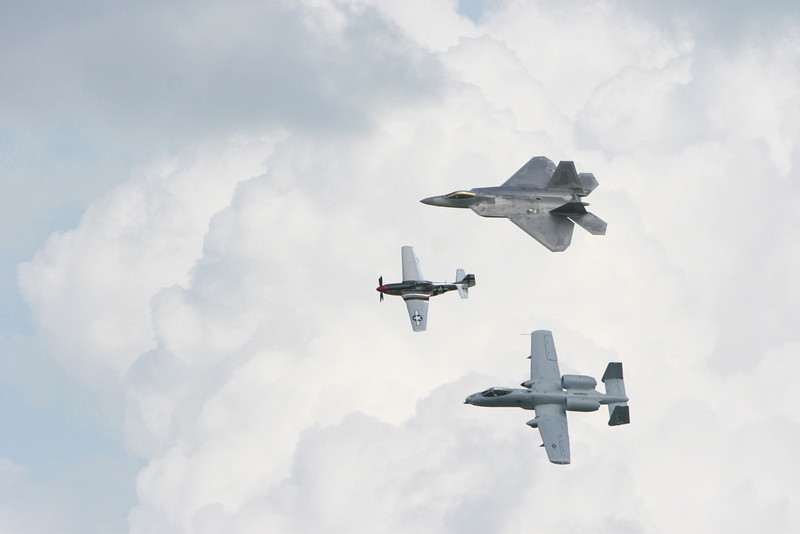 "During the day they had a few ""legacy flights"" -- pairing today's airpower with its predecessors. Top to bottom, the F-22 Raptor, the P-51 Mustang (WWII, 150,000 were produced, 150 remain mostly in private collections) and the A-10 Thunderbolt/Warthog -- A Vietnam era aircraft that is still an active part of the airstrikes in Afghanistan and Iraq today. I have a special affection for the Warthog due to Iraq."