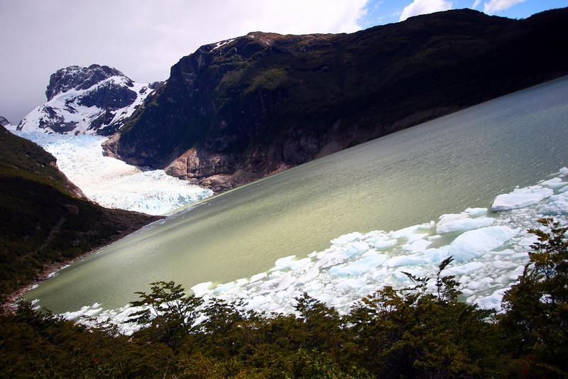 The Serrano glacier. Our boat docked and we went hiking in the mountains on a short hike to the Serrano glacier .. I traveled here in late November, which is late spring for the region. The ice was still melting as you can see along the shore ..