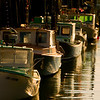 November Lobsterboats<br /> Behind Harbor Fish Market, Portland, ME<br /> All photographs are printed on high quality, professional Kodak metallic paper, unmatted, and shipped to you unframed so that you may choose your own matting and framing materials. <br /> The following sizes are available unmatted:<br /> Unmatted prices:<br /> 8 x 10  $35<br /> 11 x 14  $50<br /> 16 x 20  $75<br /> 20 x 24  $100