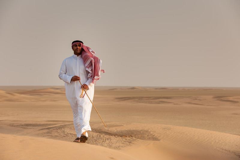 Kuwait -Man walking on the Desert