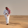 Kuwait -Man walking on the Desert