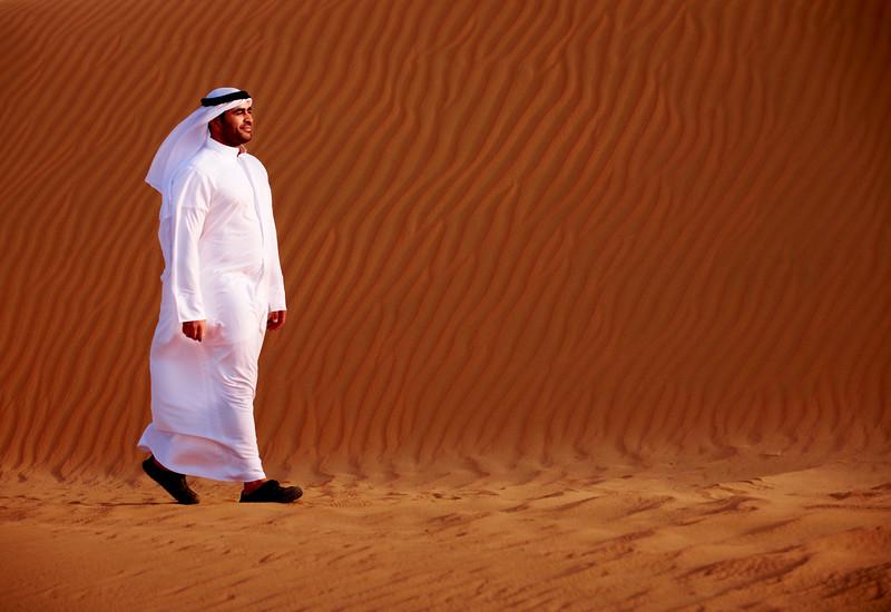 Kuwait - Man walking in desert