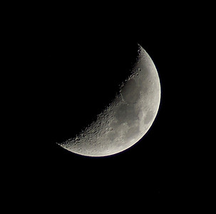 """April 27th, 2012.   This is called a Waxing Crescent. The waxing means """"growing"""" or expanding in illumination, After the new moon, the sunlit portion is increasing, but less than half, so it is waxing crescent."""