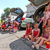 Looking up Main Street in Pepperell for the start of the 4th of July Parade are locals L-R, Sabrina Jacinto, 1 year old, Gabriel Gitau,6, Ethan Gitau,5, standing in back is Avril Jacinto, Vivana Jacinto,5,in car is Aaron Gitau,dad, holding Ezra Gitau, 5 months, girls sitting in front, Adelaide Bissell,5, Averie Bissell,7, Iyla Jacinto,3, and in car is Jennie Bissell holding Cecelia Bissell,2. Nashoba Valley Voice Photo by David H. Brow