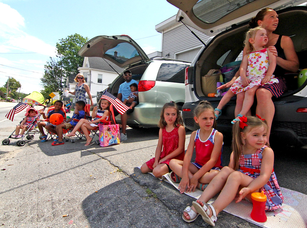. Looking up Main Street in Pepperell for the start of the 4th of July Parade are locals L-R, Sabrina Jacinto, 1 year old, Gabriel Gitau,6, Ethan Gitau,5, standing in back is Avril Jacinto, Vivana Jacinto,5,in car is Aaron Gitau,dad, holding Ezra Gitau, 5 months, girls sitting in front, Adelaide Bissell,5, Averie Bissell,7, Iyla Jacinto,3, and in car is Jennie Bissell holding Cecelia Bissell,2. Nashoba Valley Voice Photo by David H. Brow