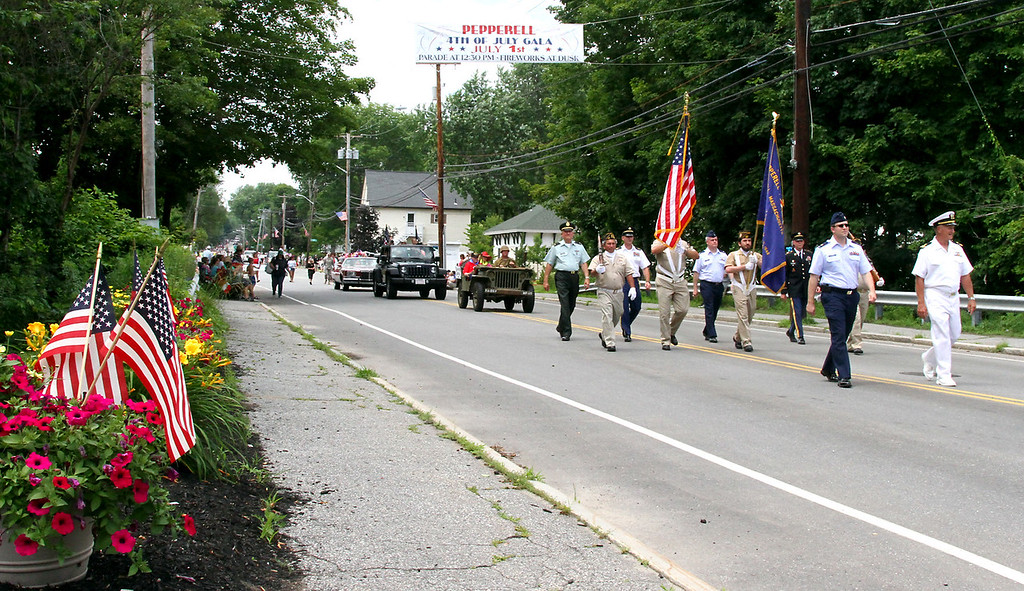 . Group leading the Pepperell 4th of July Parade down Main Street representing all branches of services. Nashoba Valley Voice Photo by David H. Brow