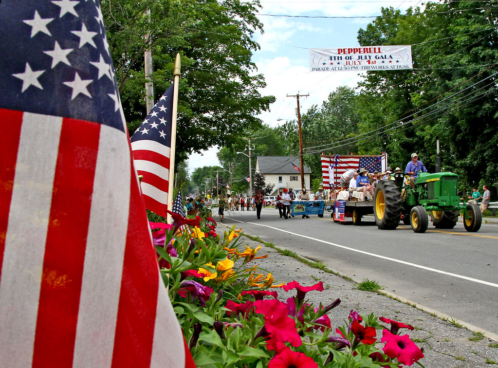 . Tractor pulls the float of the Democratic Town Committee, for the Pepperell 4th of July Parade. Nashoba Valley Voice Photo by David H. Brow