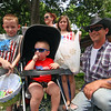 Pepperell family enjoying the 4th of July Parade in front of their house on Main Street, L-R, Joshua Coupal,8, Ryan Coupal, 2, Mary Coupal (mom and wife), Taryn Coupal,10, and dad, Phil Coupal. Nashoba Valley Voice Photo by David H. Brow