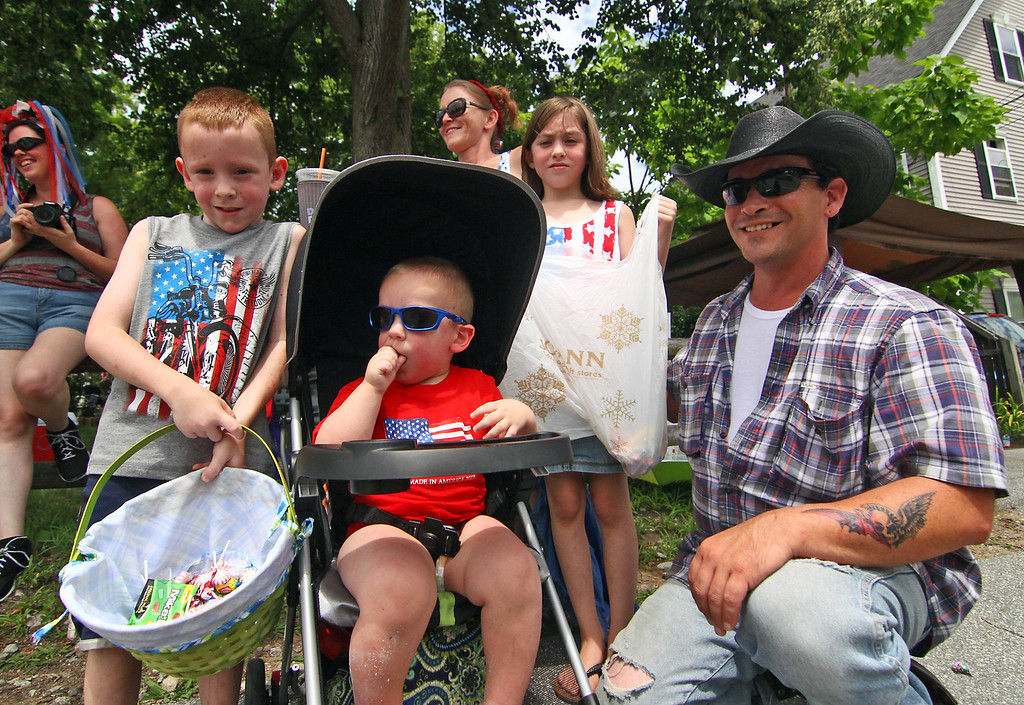 . Pepperell family enjoying the 4th of July Parade in front of their house on Main Street, L-R, Joshua Coupal,8, Ryan Coupal, 2, Mary Coupal (mom and wife), Taryn Coupal,10, and dad, Phil Coupal. Nashoba Valley Voice Photo by David H. Brow