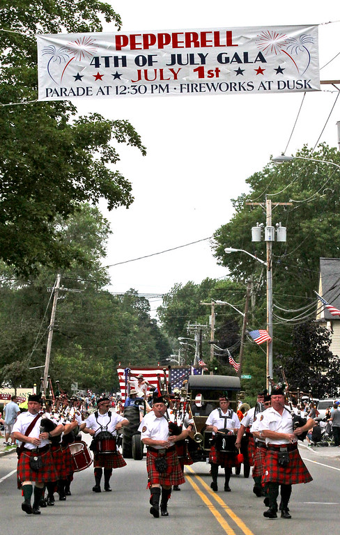 . BagPippers march under the Pepperell Banner on Main Street for the 4th of July Parade. Nashoba Valley Voice Photo by David H. Brow