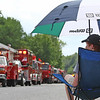 Folks watch as the last of the 4th of July Parade passes by in downtown Pepperell.Nashoba Valley Voice Photo by David H. Brow