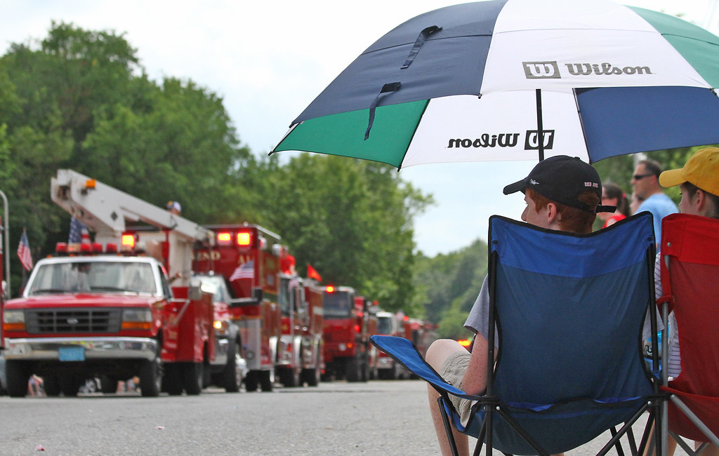 . Folks watch as the last of the 4th of July Parade passes by in downtown Pepperell.Nashoba Valley Voice Photo by David H. Brow