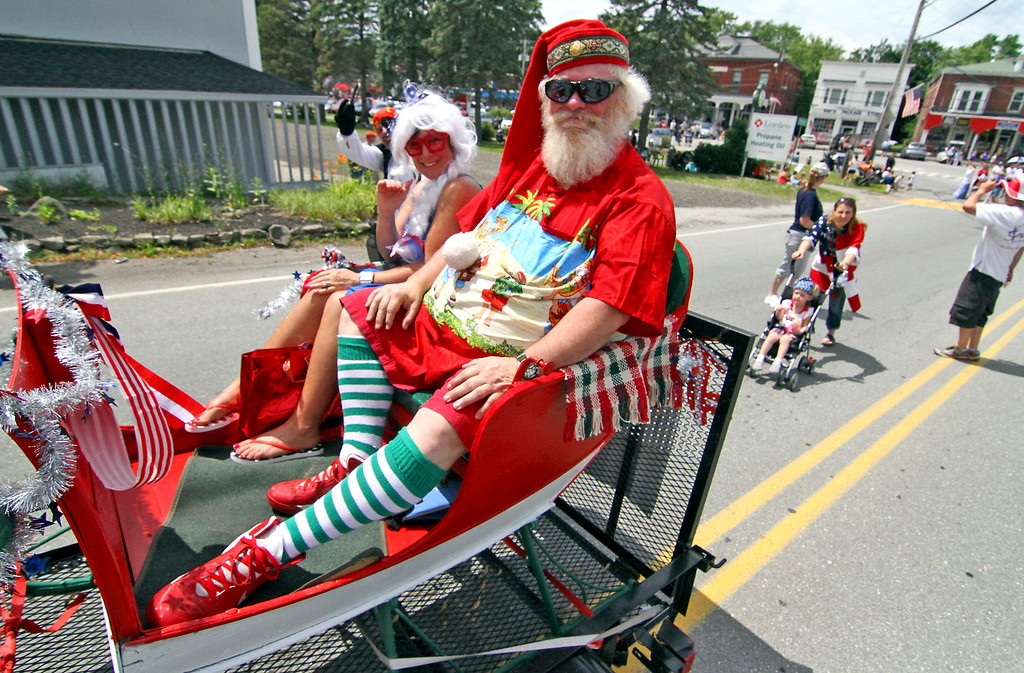 . Chritmas in July, it\'s Santa Bob, or in this case Santa Pepperell shown here in the 4th of July Parade in Pepperell. Nashoba Valley Voice Photo by David H. Brow