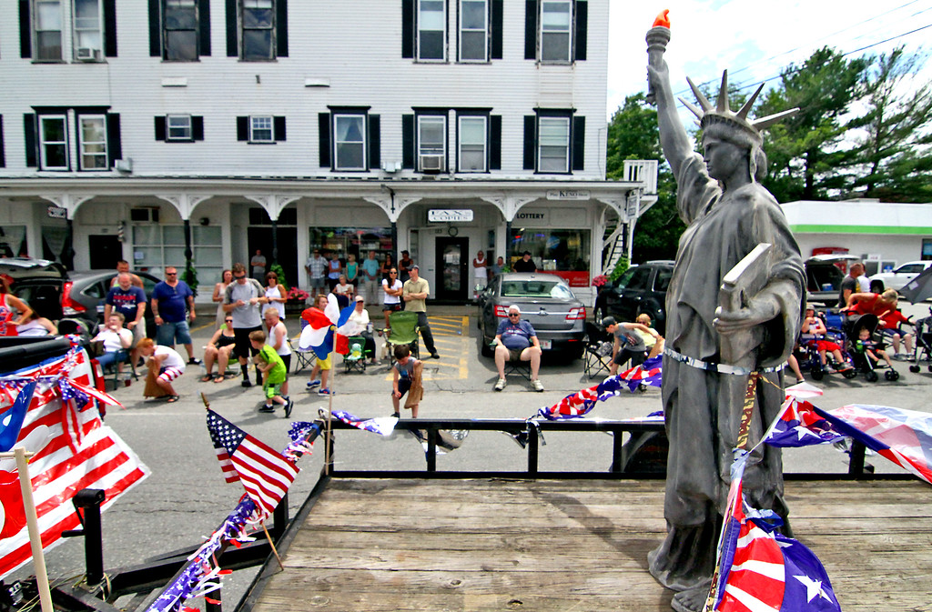 . Lady Liberty moves along the parade route on a float from a Pepperell landscape co., in the Pepperell 4th of July Parade. Nashoba Valley Voice Photo by David H. Brow