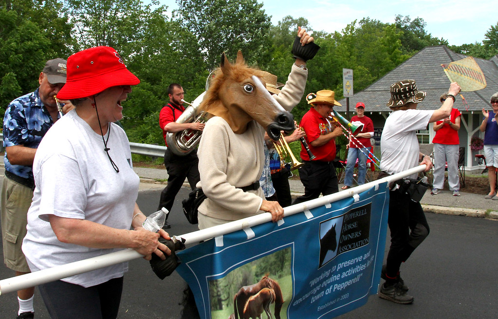 . Group marching in Pepperell 4th July Parade are the Pepperell Horse Owners Assoc.,. Nashoba Valley Voice Photo by David H. Brow