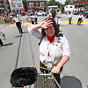 Melissa Mahady wipes the sweat during a break in the Pepperell 4th of July Parade in downtown Pepperell, she is a member of the Boston Wind Jammers Band. Nashoba Valley Voice Photo by David H. Brow
