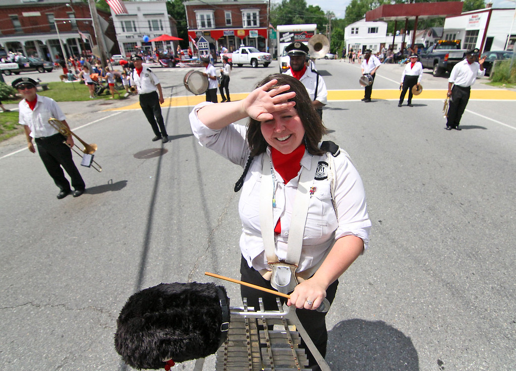 . Melissa Mahady wipes the sweat during a break in the Pepperell 4th of July Parade in downtown Pepperell, she is a member of the Boston Wind Jammers Band. Nashoba Valley Voice Photo by David H. Brow