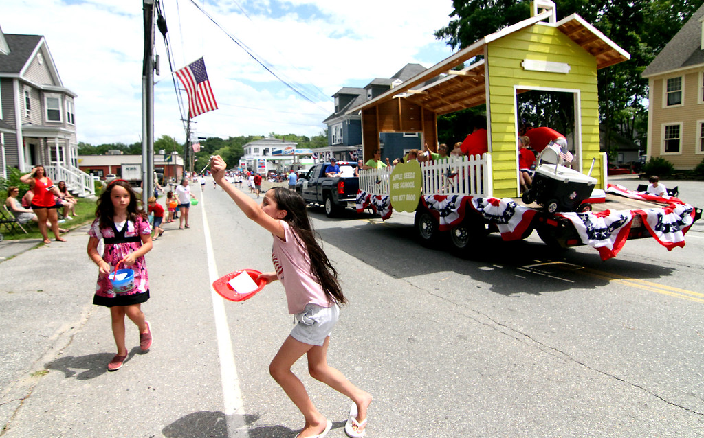 . The kids are very happy about the Pepperell 4th of July Parade because of the candy toss from the parade floats. Nashoba Valley Voice Photo by David H. Brow