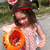 Little 3 year old Kaylee Reynolds shows her candy stash from the 4th of July Parade in Pepperell. Nashoba Valley Voice Photo by David H. Brow