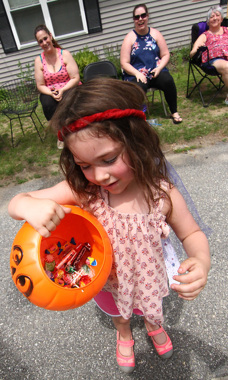 . Little 3 year old Kaylee Reynolds shows her candy stash from the 4th of July Parade in Pepperell. Nashoba Valley Voice Photo by David H. Brow