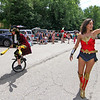 Here making their way in the Pepperell parade is L-R, Steven Paananen, balloon artist, juggler and unicyclist, and Kate Jurdi, playing Wonder Woman. Nashoba Valley Voice Photo by David H. Brow