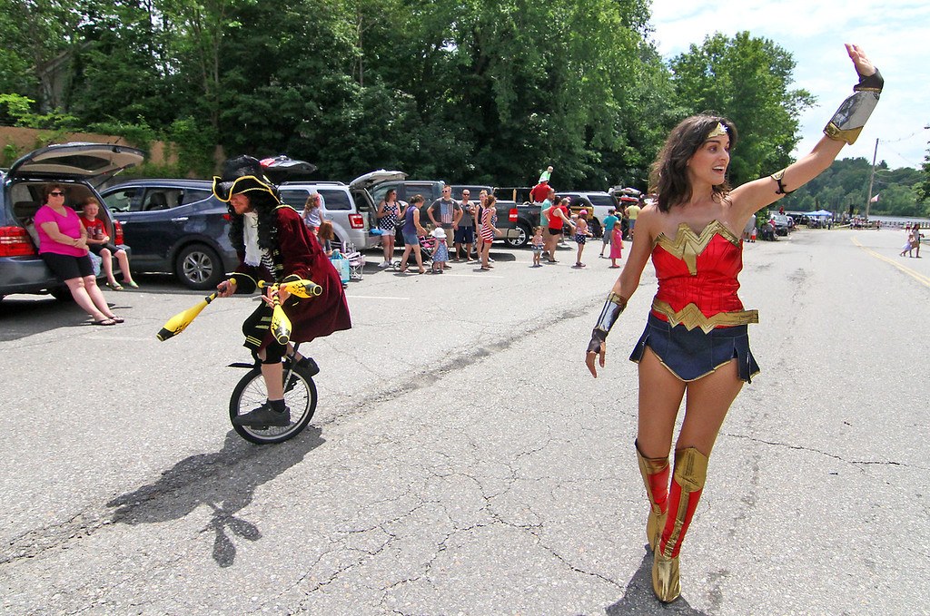 . Here making their way in the Pepperell parade is L-R, Steven Paananen, balloon artist, juggler and unicyclist, and Kate Jurdi, playing Wonder Woman. Nashoba Valley Voice Photo by David H. Brow