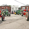A group of tractors drive through downtown Pepperell in the 4th of July Parade. Nashoba Valley Voice Photo by David H. Brow