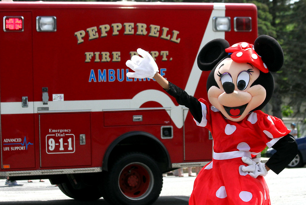 . Minnie Mouse waves to the crowd as local fire trucks pass by in the Pepperell 4th of July Parade. Nashoba Valley Voice Photo by David H. Brow
