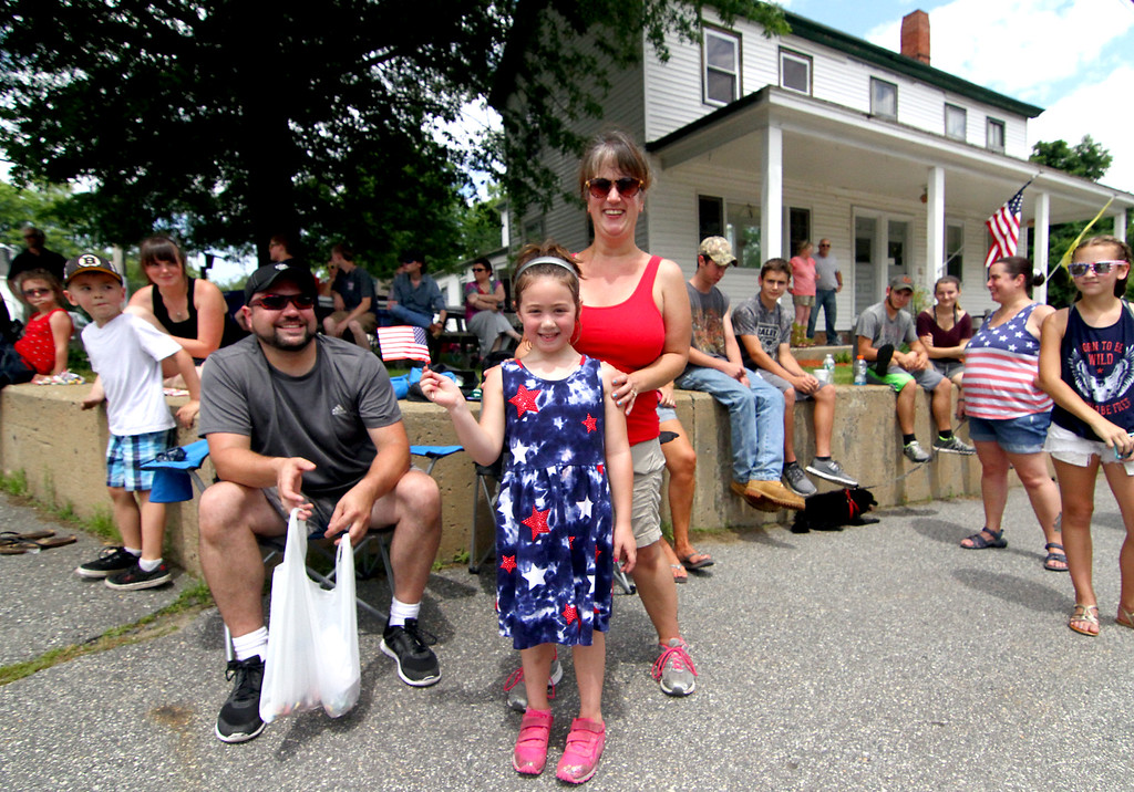 . Emily Young, 6 1/2, shows her pride waving an American Flag, with her dad, Steve Young and mom, Cindy Young, as the Pepperell 4th of July Parade passes by. Nashoba Valley Voice Photo by David H. Brow